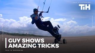 Guy Shows Amazing Tricks While Kite Landboarding At Beach