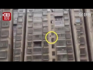 Chinese schoolgirl is saved after plunging 15 storeys