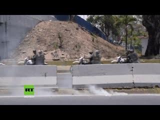 Venezuela: guaidó-anhänger verwandeln straßen von caracas in schlachtfelder