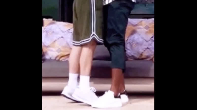 Louis tomlinson standing on his tiptoes
