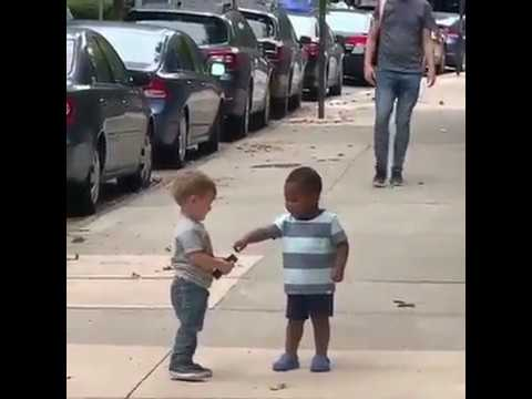 TWO TODDLERS EMBRACE ON SIDEWALK GOES VIRAL