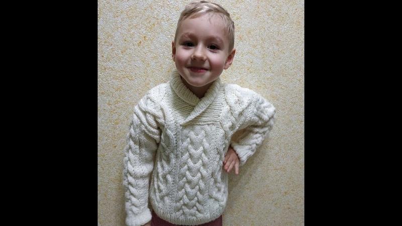 Вязание джемпера для мальчика с аранскими косами Knitting of a jumper for the boy with